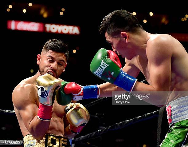 Leo Santa Cruz lands a punch on Abner Mares of Mexico during the first round of the WBC diamond featherweight and WBA featherweight championship bout...