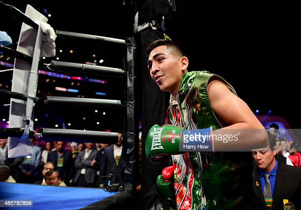 Leo Santa Cruz makes his way to the ring to fight Abner Mares of Mexico during the WBC diamond featherweight and WBA featherweight championship bout...