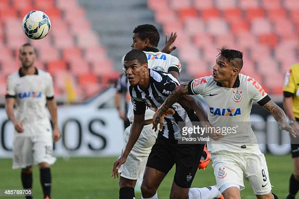 Leo Silva of Atletico MG and Ze Paulo and Guerrero of Corinthians battle for the ball during a match between Atletico MG and Corinthians as part of...