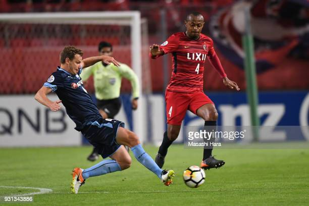 Leo Silva of Kashima Antlers and Alex Wilkinson of Sydney FC compete for the ball during the AFC Champions League Group H match between Kashima...