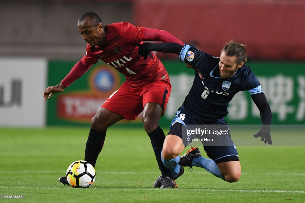 Leo Silva of Kashima Antlers and Joshua Brillante of Sydney FC compete for the ball during the AFC Champions League Group H match between Kashima Antlers and Sydney FC at Kashima Soccer Stadium on March 13, 2018 in Kashima, Ibaraki, Japan.