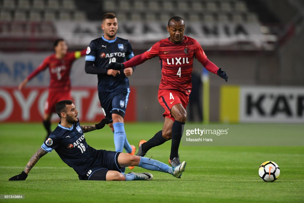 Leo Silva of Kashima Antlers and Kalik Anthony of Sydney FC compete for the ball during the AFC Champions League Group H match between Kashima Antlers and Sydney FC at Kashima Soccer Stadium on March 13, 2018 in Kashima, Ibaraki, Japan.
