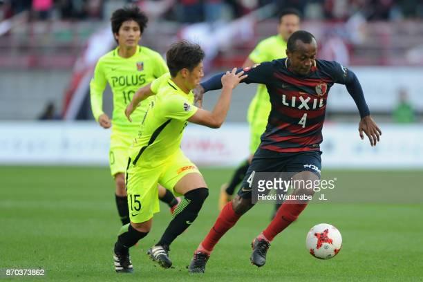 Leo Silva of Kashima Antlers and Kazuki Nagasawa of Urawa Red Diamonds compete for the ball during the JLeague J1 match between Kashima Antlers and...