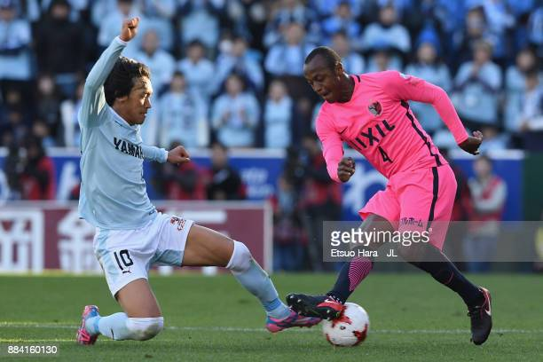 Leo Silva of Kashima Antlers and Shunsuke Nakamura of Jubilo Iwata compete for the ball during the JLeague J1 match between Jubilo Iwata and Kashima...