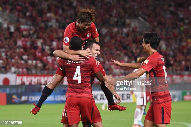Leo Silva of Kashima Antlers celebrates kicking a goal with team mates during the AFC Champions League Round of 16 first leg match between Kashima...