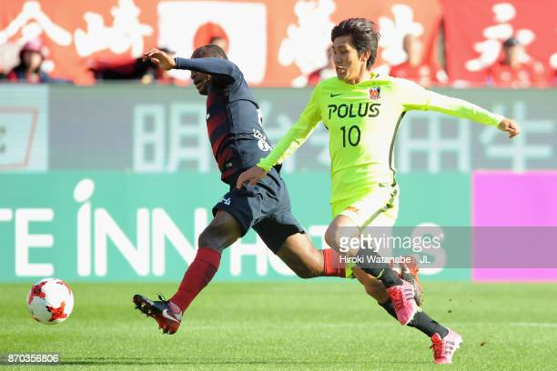 Leo Silva of Kashima Antlers is challenged by Yosuke Kashiwagi of Urawa Red Diamonds during the JLeague J1 match between Kashima Antlers and Urawa...