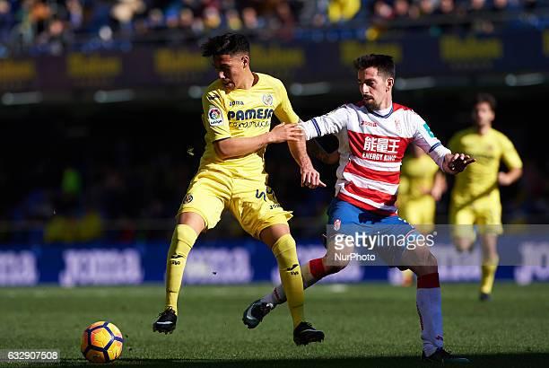 Leo Suarez of Villarreal CF and Isaac Cuenca of Granada CF during their La Liga match between Villarreal CF and Granada CF at the Estadio de la...