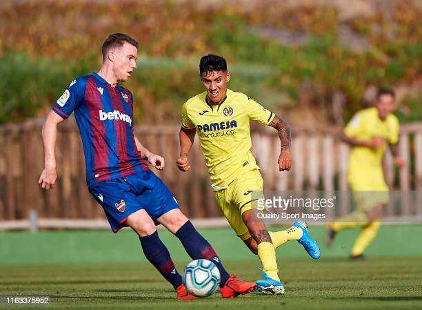 Leo Suarez of Villarreal CF competes for the ball with Carlos Clerc of Levante during a PreSeason Friendly match between Villarreal and Levante on...