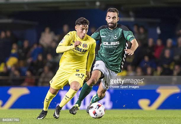 Leo Suarez of Villarreal CF fights for the ball with Carlos Tornero López de Lerma of CD Toledo during their Copa del Rey 201617 match between...