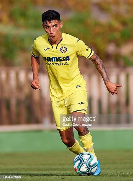Leo Suarez of Villarreal CF runs with the ball during a PreSeason Friendly match between Villarreal and Levante on July 20 2019 in Parador El Saler...