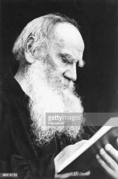 Leo Tolstoy reading a book, circa 1910. .