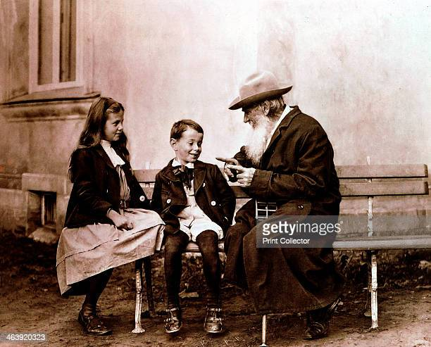 Leo Tolstoy, Russian writer, philosopher and mystic, telling his grandchildren a story, c1890-1910. From the British Museum.