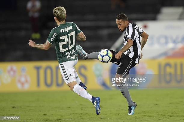 Leo Valencia of Botafogo struggles for the ball with Lucas Lima of Palmeiras during the match between Botafogo and Palmeiras as part of Brasileirao...