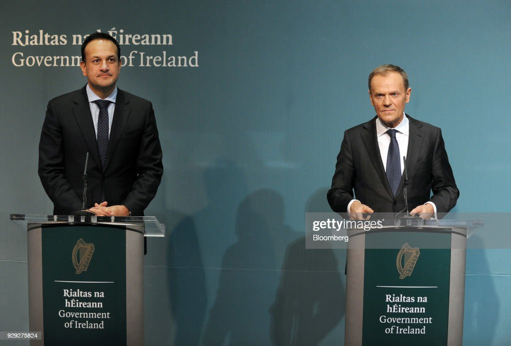 Leo Varadkar, Ireland's prime minister, left, looks on as Donald Tusk, president of the European Union (EU), speaks during a news conference at the Government Buildings in Dublin, Ireland, on Thursday, March 8, 2018. The U.K. is beginning to understand the strength of the European Unions negotiating power, Varadkar said. Photographer: Aidan Crawley/Bloomberg via Getty Images
