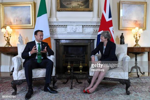 Leo Varadkar Ireland's prime minister left speaks to Theresa May UK prime minister during their meeting inside number 10 Downing Street in London UK...