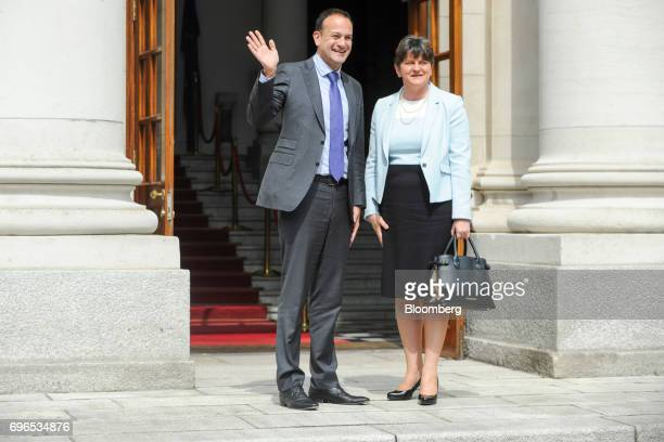 Leo Varadkar Ireland's prime minister left waves as he greets Arlene Foster leader of the Democratic Unionist Party at the Government Buildings in...