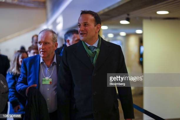 Leo Varadkar Ireland's prime minister right walks through the Congress Center on day three of the World Economic Forum in Davos Switzerland on...