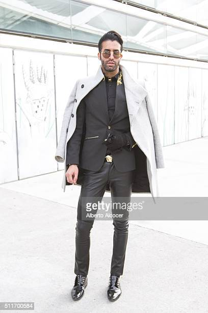 Leo wears Givenchy shoes Pants Leonorma Jacket Leonorma Zara coat Rayban Sunglasses Givenchy bracelet and Versace belt during Mercedes Benz Fashion...