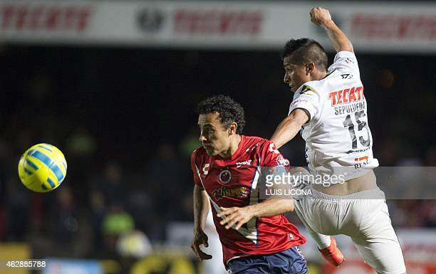Leobardo Lopez of Veracruz vies for the ball with Angel Sepulveda of Queretaro during their Mexican Clausura tournament football match at the Luis...