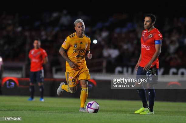 Leobardo Lopez of Veracruz watches Eduardo Vargas of Tigres driving the ball during the Mexican Apertura 2019 tournament football match at Luis...