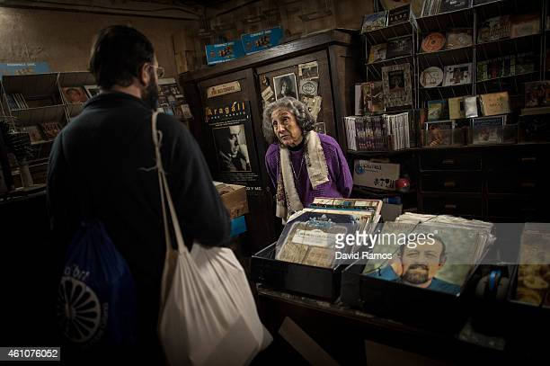 Leocadia Peris help a customer at the casette tapes and LP department of Musical Emporium during his last day open to the public on January 5 2015 in...