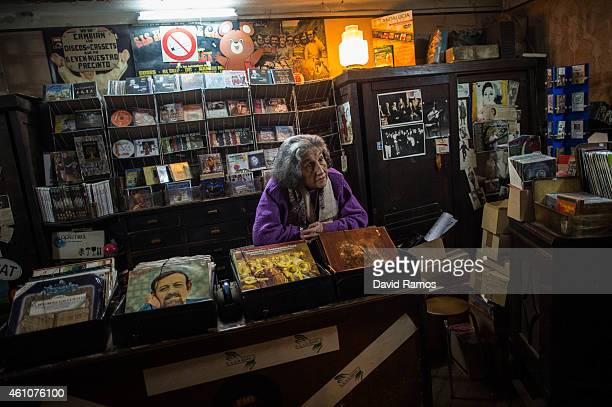 Leocadia Peris looks on as she waits for customers at the casette tapes and LP department of Musical Emporium during his last day open to the public...