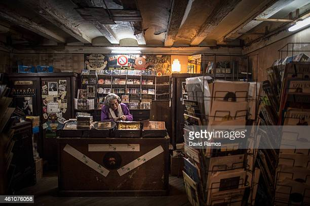 Leocadia Peris works at the casette tapes and LP department of Musical Emporium during his last day open to the public on January 5 2015 in Barcelona...