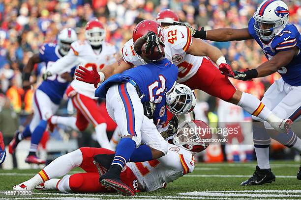Leodis McKelvin of the Buffalo Bills has the ball stripped by Anthony Sherman of the Kansas City Chiefs during the second half at Ralph Wilson...