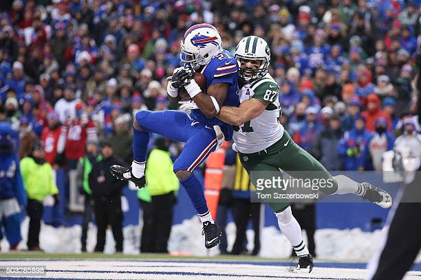 Leodis McKelvin of the Buffalo Bills intercepts the ball in the endzone as Eric Decker of the New York Jets defends during the second half at Ralph...