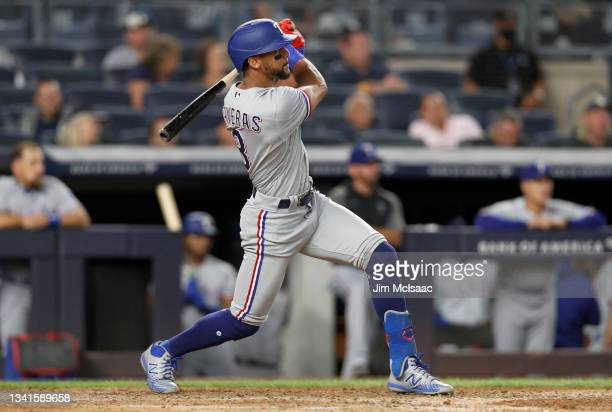 Leody Taveras of the Texas Rangers follows through on a fifth inning ground rule double against the New York Yankees at Yankee Stadium on September...