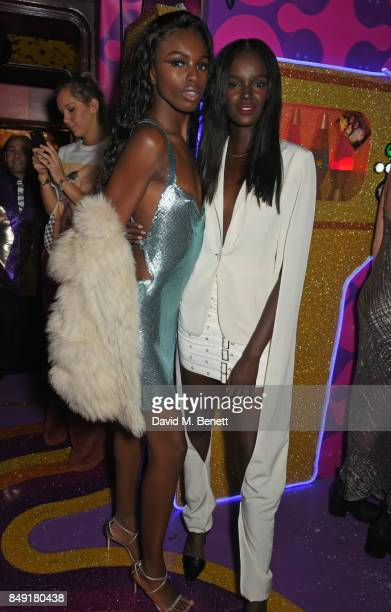 Leomie Anderson and Duckie Thot attend the LOVE magazine x Miu Miu party held during London Fashion Week at Loulou's on September 18 2017 in London...