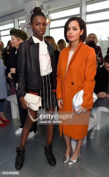 Leomie Anderson and Georgina Campbell attend the Jigsaw London Fashion Week show on February 21 2017 in London England