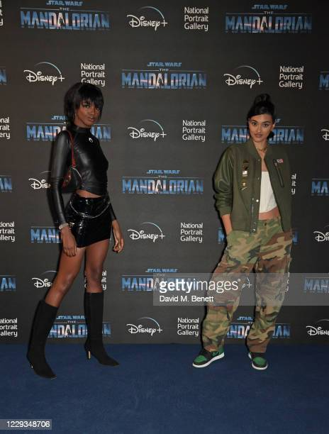 """Leomie Anderson and Neelam Gill attend a private view of """"The Mandalorian And The Child"""", a special portrait being unveiled in collaboration with the..."""