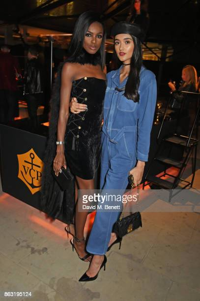 Leomie Anderson and Neelam Gill attend The Veuve Clicquot Widow Series By Carine Roitfeld And CR Studio on October 19 2017 in London England