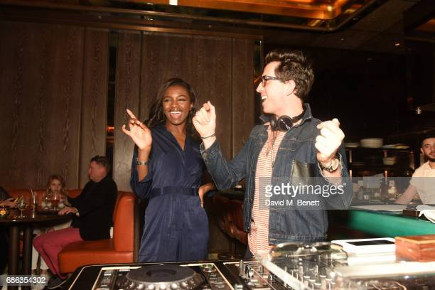 Leomie Anderson and Nick Grimshaw fool around at Nick Grimshaw's Sexy Brunch at Sexy Fish on May 21 2017 in London England