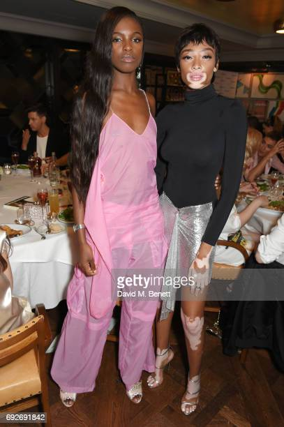 Leomie Anderson and Winnie Harlow attend the Wonderland Summer Issue dinner hosted by Madison Beer at The Ivy Soho Brasserie on June 5 2017 in London...