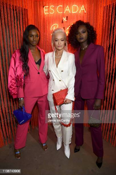 Leomie Anderson Rita Ora and Duckie Thot attend the launch of the ESCADA Heartbag by Rita Ora on March 27 2019 in New York City