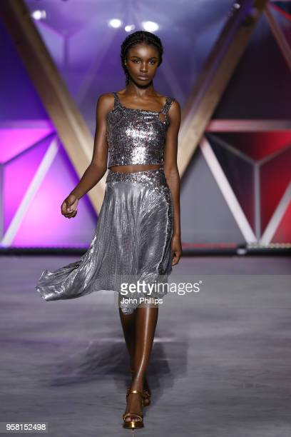 Leomie Anderson walks the Runway at Fashion for Relief Cannes 2018 during the 71st annual Cannes Film Festival at Aeroport Cannes Mandelieu on May 13...