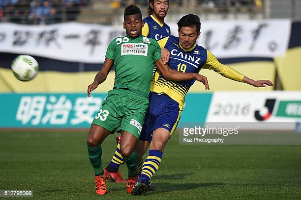 Leomineiro of FC Gifu and Yugo Ichiyanagi of Thespa Kusatsu Gunma compete for the ball during the JLeague second division match between Thespa...