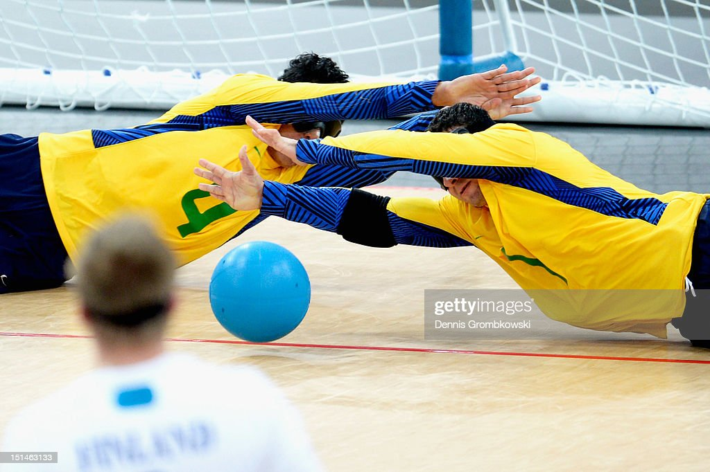 Leomon Moreno Da Silva of Brazil and teammate Jose Roberto Ferreira De Oliveira block the ball during their Men's Team Goalball Gold Medal match against Finland on day 9 of the London 2012 Paralympic Games at The Copper Box on September 7, 2012 in London, England.