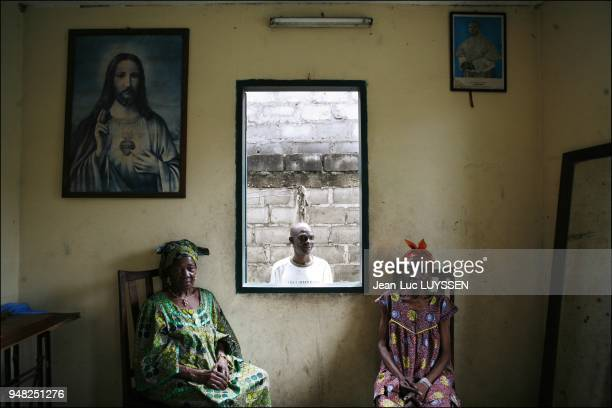 Leon 43 years old HIV sufferer treated at the Pointe Noire CTA Between his mother Helene on the left and his grandmother Philomene on the right Leon...