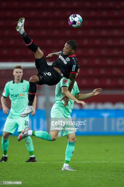 Leon Bailey of Bayer 04 Leverkusen and Laszlo Benes of Borussia Moenchengladbach battle for the ball during the Bundesliga match between Bayer 04...