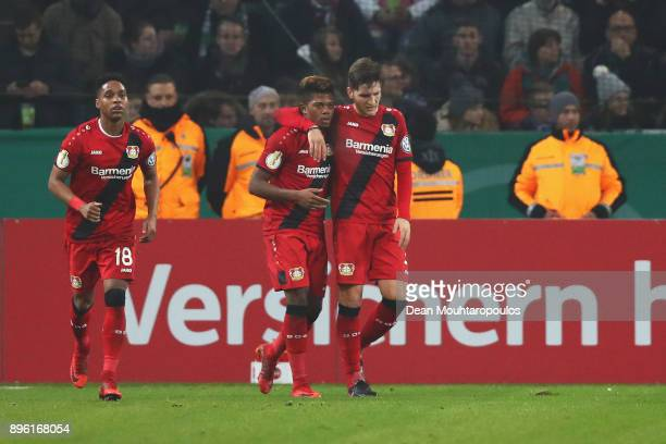 Leon Bailey of Bayer 04 Leverkusen celebrates scoring his teams first goal of the game with team mates during the DFBPokal match between Borussia...
