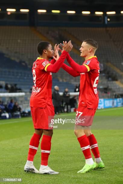 Leon Bailey of Bayer 04 Leverkusen celebrates with teammate Florian Wirtz after scoring his team's first goal during the Bundesliga match between DSC...