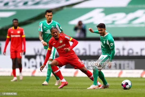 Leon Bailey of Bayer 04 Leverkusen is challenged by Leonardo Bittencourt of SV Werder Bremen during the Bundesliga match between SV Werder Bremen and...