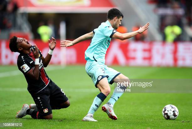 Leon Bailey of Bayer 04 Leverkusen reacts as Aaron of FSV Mainz looks to control the ball during the Bundesliga match between Bayer 04 Leverkusen and...