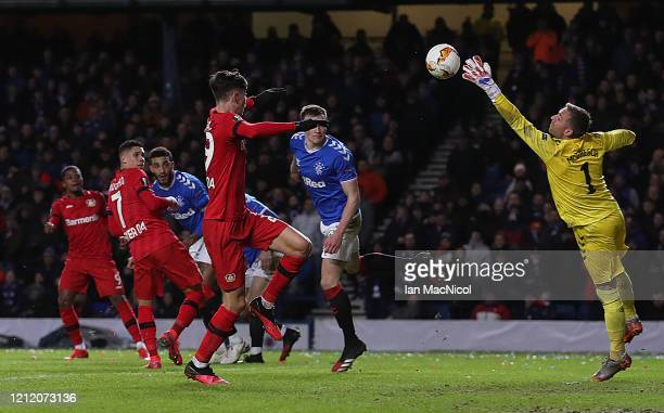 Leon Bailey of Bayer 04 Leverkusen scores his team's third goal during the UEFA Europa League round of 16 first leg match between Rangers FC and...