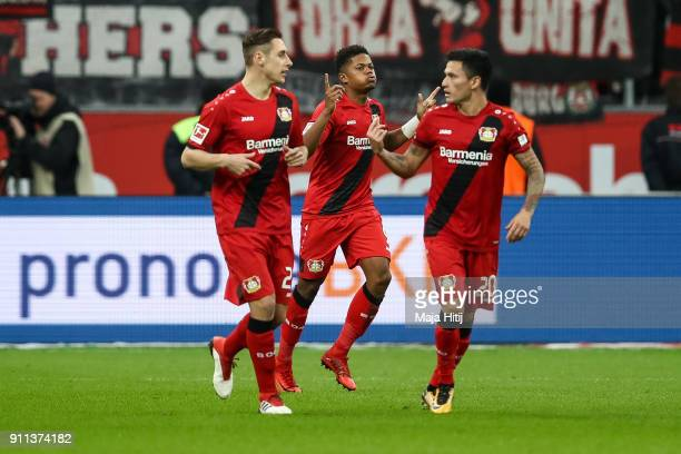 Leon Bailey of Bayer Leverkusen celebrates with his teammates after scoring his teams first goal to make it 10 during the Bundesliga match between...