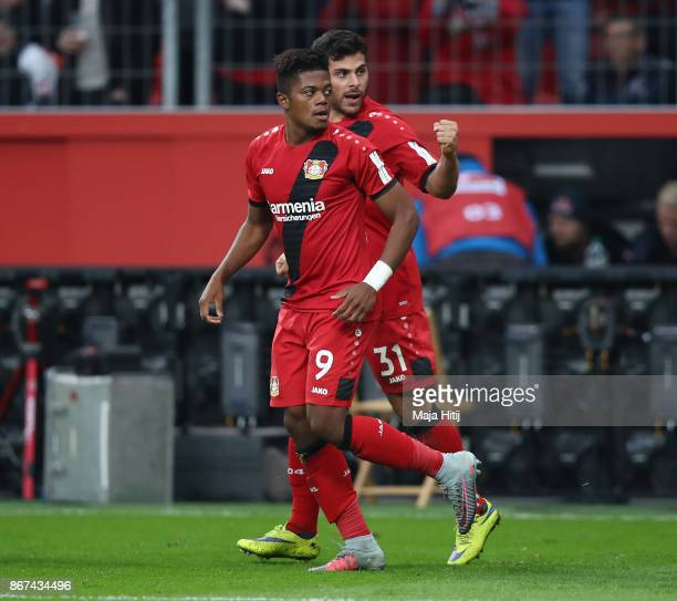 Leon Bailey of Bayer Leverkusen celebrates with Kevin Volland of Bayer Leverkusen after he scored his teams first goal to make it 11 during the...