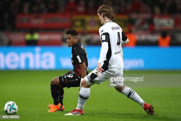 Leon Bailey of Bayer Leverkusen fights for the ball with Jannik Vestergaard of Moenchengladbach during the Bundesliga match between Bayer 04...